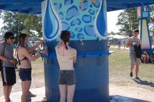 Katie filling a water bottle at Bonnaroo. This was a regular and required duty in the Tennessee heat. All photo by Patti Wenzel